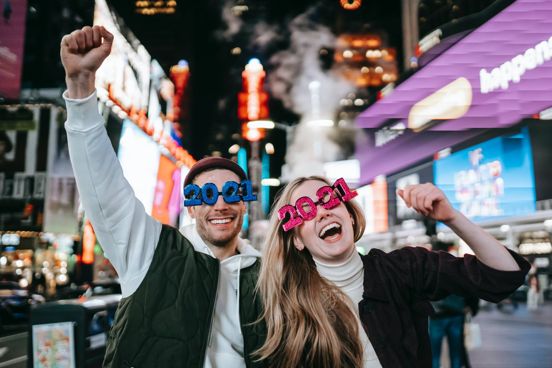 cheerful couple in decorative glasses on street